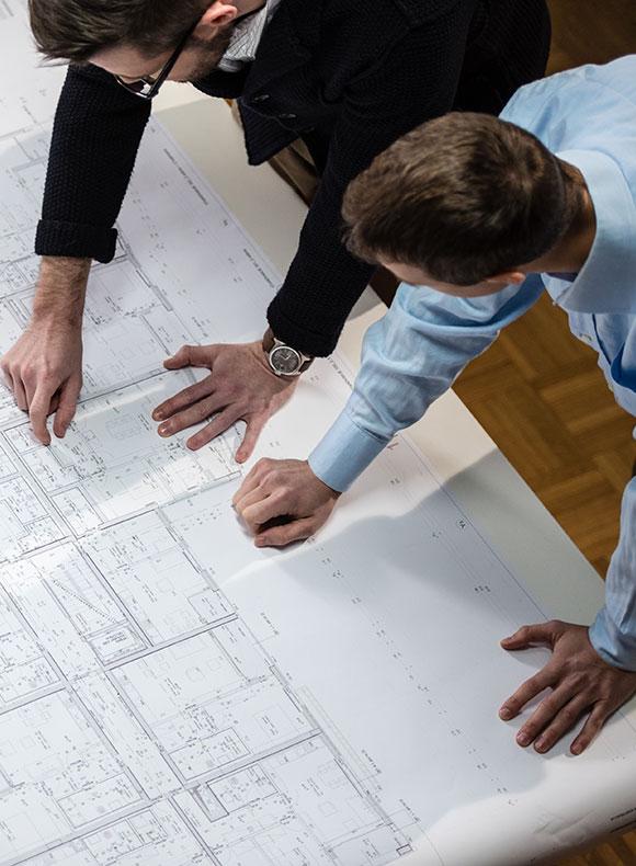 Men looking over blueprints