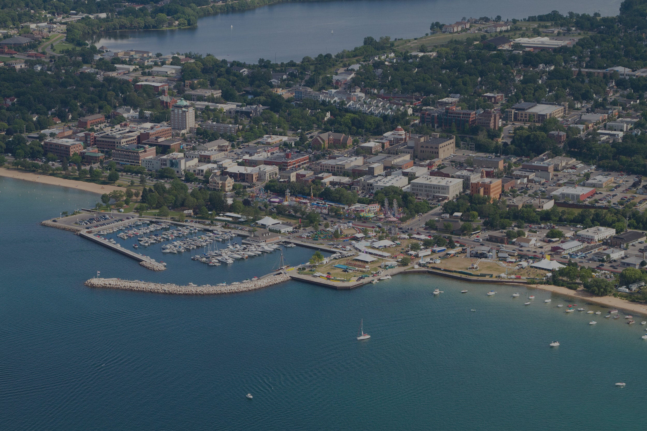 Aerial shot of Grand Traverse Bay and downtown Traverse City in the summer