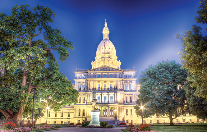 Nighttime photo of the Michigan State Capitol Building.